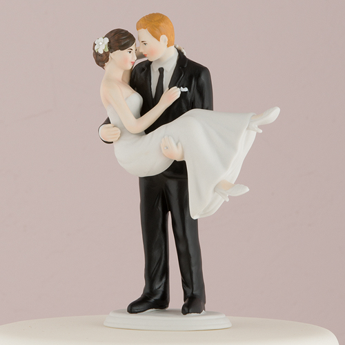 cake-topper-swept-up-in-his-arms