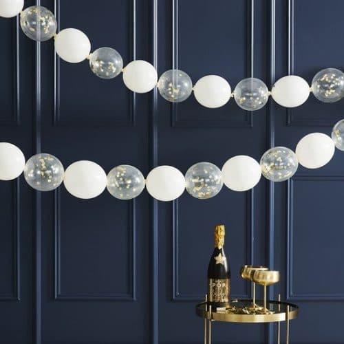 bruiloft-decoratie-confetti-ballonnen-slinger-gold-white-pop-the-bubbly.jpg