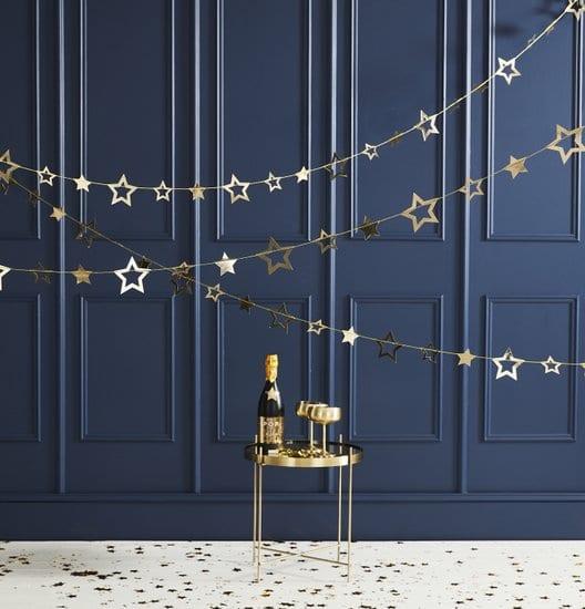 bruiloft-decoratie-slinger-gold-foiled-star-pop-the-bubbly.jpg